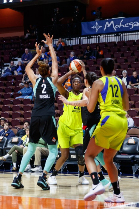 Dallas Wings Breanna Lewis (22) and New York Liberty center Mercedes Russell (2)