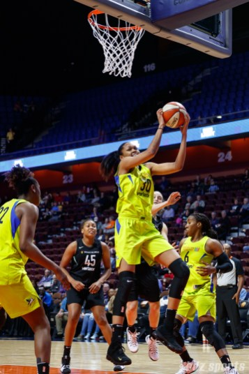 Dallas Wings Azura Stevens (30) with the rebound