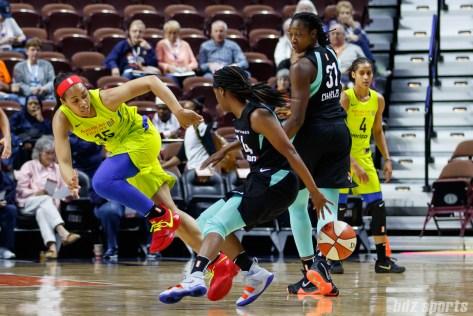 Dallas Wings guard Allisha Gray (15) and New York Liberty guard Sugar Rodgers (14)