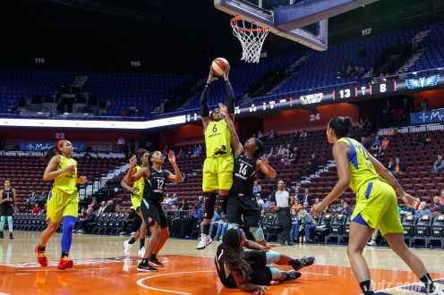 Dallas Wings Kayla Thornton (6) with the rebound