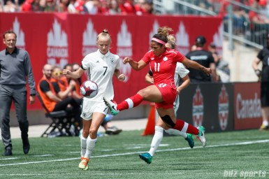 Team Germany forward Lea Schuller (7) and Team Canada midfielder Desiree Scott (11)