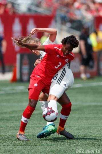 Team Canada defender Kadeisha Buchanan (3) and Team Germany midfielder Lena Goessling (8)