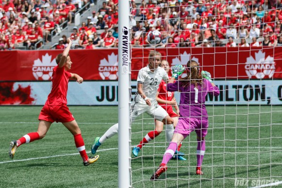 Team Germany forward Lena Petermann (28) looks to head the ball into the back of the net
