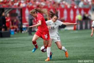 Team Germany midfielder Sara Dabritz (13) and Team Canada forward Janine Beckie (16)