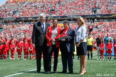 Candace Chapman is honored before the game for being inducted into the Canadian Soccer Hall of Fame