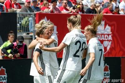 Team Germany celebrates forward Svenja Huth's (19) goal