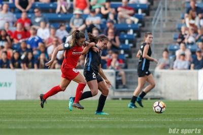 Portland Thorns midfielder Andressinha (8) and Chicago Red Stars midfielder Danielle Colaprico (24)