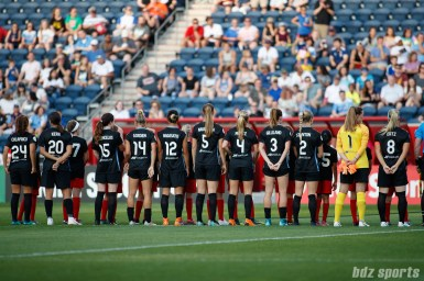The Chicago Red Stars line up for the playing of the national anthem