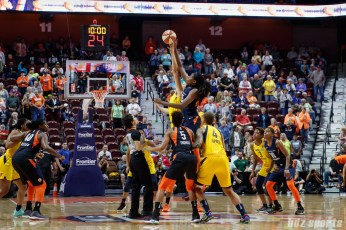 Indiana Fever forward Natalie Achonwa (11) and Connecticut Sun center Jonquel Jones (35) take the opening tip off