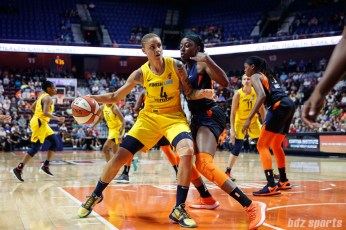 Indiana Fever forward Candice Dupree (4) and Connecticut Sun forward Chiney Ogwumike (13)