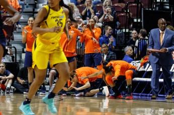 Connecticut Sun guards Rachel Banham (1) Alex Bentley (20) to one of Shekinna Stricklen's (not pictured) four 3-pointer