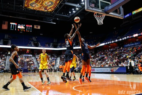 Connecticut Sun players Courtney Williams (10) and Chiney Ogwumike (13)