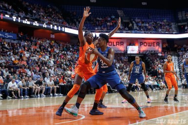 Minnesota Lynx center Sylvia Fowles (34) and Connecticut Sun forward Chiney Ogwumike (13)