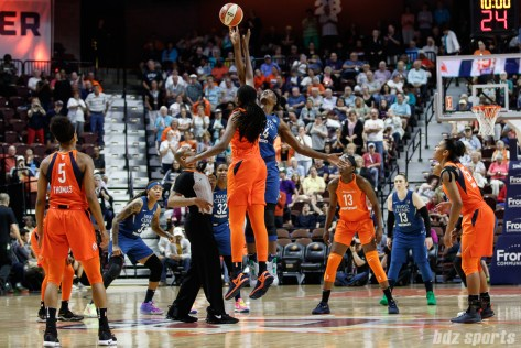 Minnesota Lynx center Sylvia Fowles (34) takes the opening tip off against Connecticut Sun center Jonquel Jones (35)