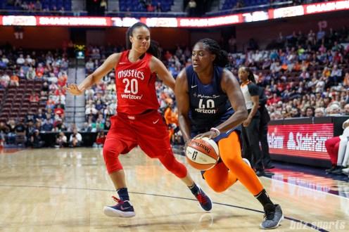 Connecticut Sun forward Shekinna Stricklen (40) and Washington Mystics guard Kristi Toliver (20)