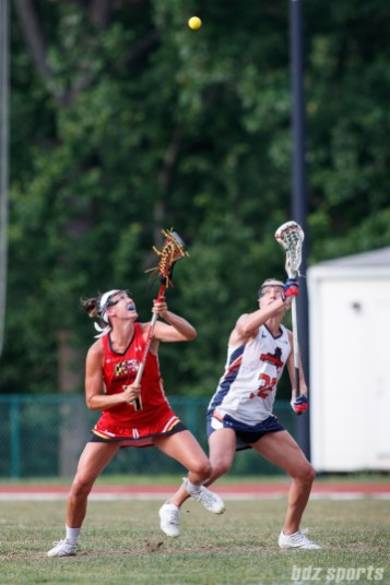 Baltimore Brave midfielder Marie McCool (4) and Upstate Pride midfielder Ally Carey (32)