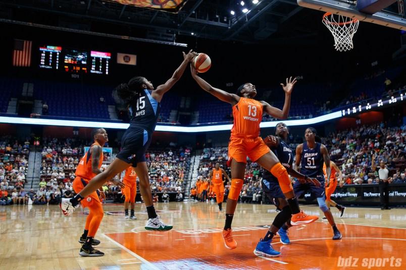 Atlanta Dream guard Tiffany Hayes (15) and Connecticut Sun forward Chiney Ogwumike (13)