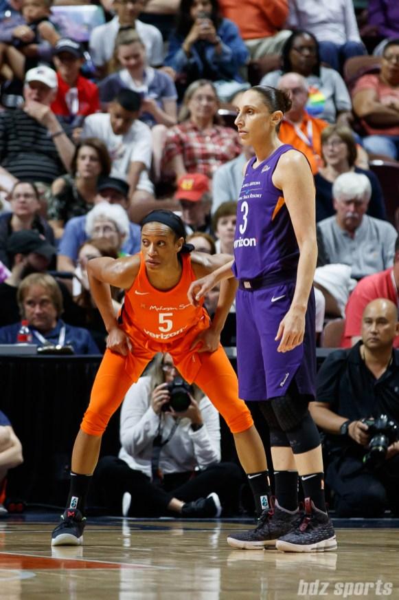 Connecticut Sun guard Jasmine Thomas (5) and Phoenix Mercury guard Diana Taurasi (3)