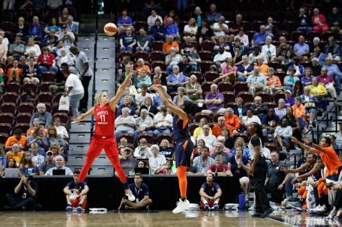 Washington Mystics forward Elena Delle Donne (11) and Connecticut Sun forward Morgan Tuck (33)