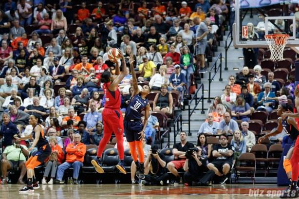 Washington Mystics guard Ariel Atkins (7) and Connecticut Sun guard Courtney Williams (10)