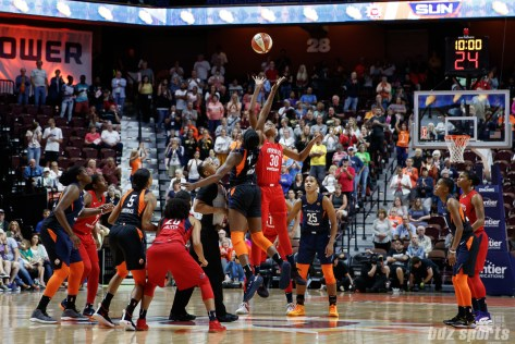 Connecticut Sun forward Chiney Ogwumike (13) and Washington Mystics forward LaToya Sanders (30) take the opening tip off