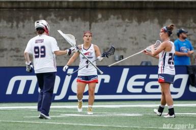 New England Command goalie Emily Leitner (99), defender Amber Mckenzie (1), and defender Katie Hertsch (25)