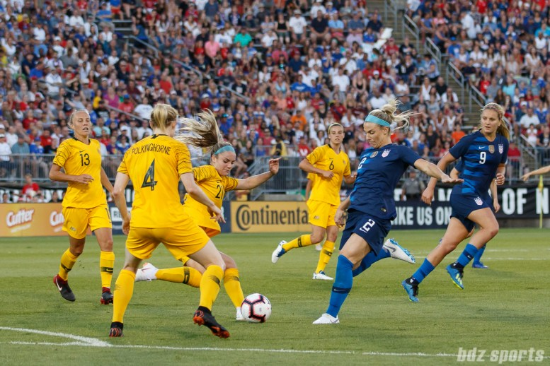Team Australia defender Ellie Carpenter (21) and Team USA defender Julie Ertz (2)