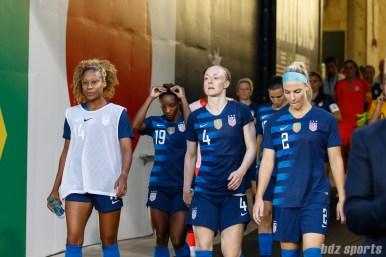 Team USA players Casey Short (14), Crystal Dunn (19), Becky Sauerbrunn (4), and Julie Ertz (2)