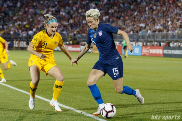 Team USA midfielder Megan Rapinoe (15) and Team Australia defender Ellie Carpenter (21)