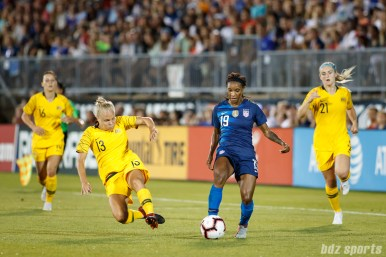 Team Australia midfielder Tameka Butt (13) and Team USA forward Crystal Dunn (19)