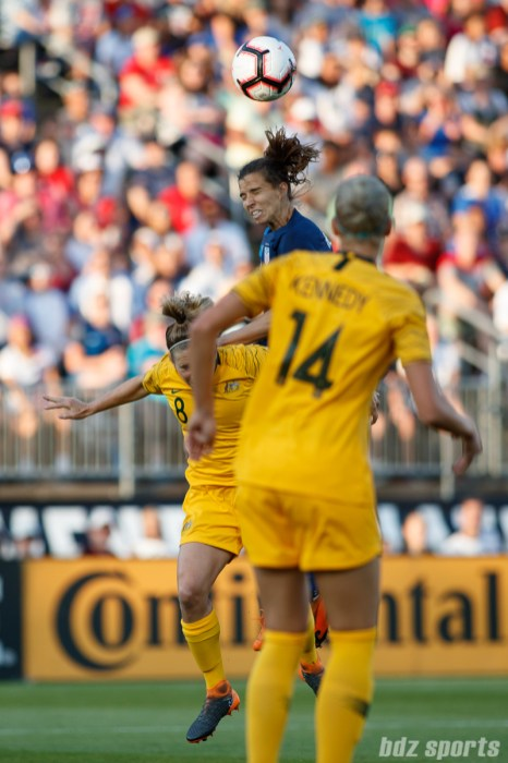 Team Australia midfielder Elise Kellond-Knight (8) and Team USA forward Tobin Heath (17)