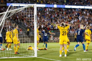 The Australian team reacts after Team USA midfielder Lindsey Horan (not pictured) scores to tie the game in the 90th minute