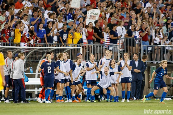 Team USA bench reacts after midfielder Lindsey Horan's goal in the 90th minute