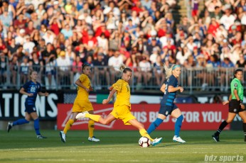 Team Australia midfielder Emily Van Egmond (10)