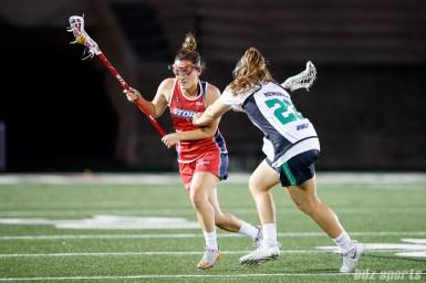 Boston Storm defender Brenna Rainone (17) and Philadelphia Force attacker Molly Hendrick (23)