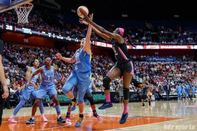 Chicago Sky center Stefanie Dolson (31) and Connecticut Sun forward Chiney Ogwumike (13)
