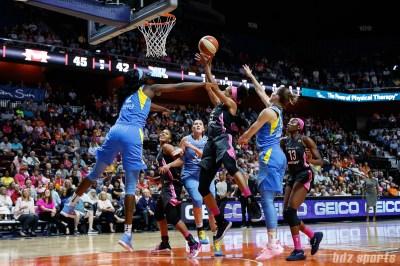Connecticut Sun guard Jasmine Thomas (5) and Chicago Sky forward Kahleah Copper (2)