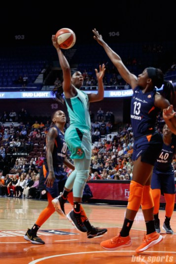 New York Liberty guard Sugar Rodgers (14) and Connecticut Sun forward Chiney Ogwumike (13)