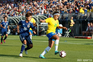 Team Brazil defender Monica (21) and Team Japan midfielder Rika Masuya (19)