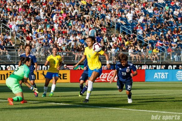 Team Japan midfielder Rika Masuya (19) scores on a diving header in the 88th minute