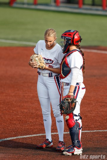 USSSA Pride pitcher Jessica Burroughs (16) and USSSA Pride catcher Chelsea Goodacre (77)