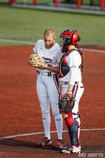 USSSA Pride pitcher Jessica Burroughs (16) and USSSA Pride catcher Chelsea Goodacre (77)