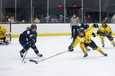Minnesota Whitecaps forward Jonna Curtis (3) and Boston Pride defender Alyssa Gagliardi (2)