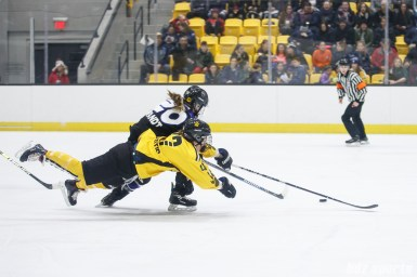 Boston Pride defender Mallory Souliotis (47) and Minnesota Whitecaps forward Hannah Brandt (20)