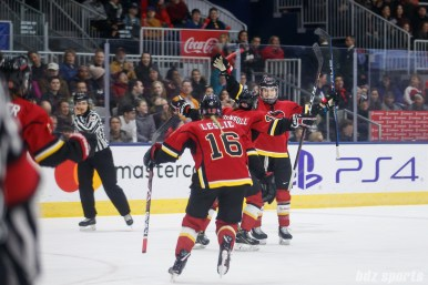 The Calgary Inferno celebrate defender Halli Krzyzaniak's (21) goal