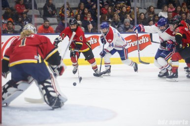 Calgary Inferno defender Brigette Lacquette (3) and Montreal Les Canadiennes forward Ann-Sophie Bettez (24)