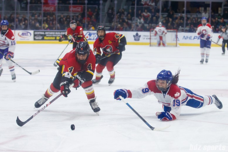 Calgary Inferno defender Brigette Lacquette (4) and Montreal Les Canadiennes forward Katia Clement-Heydra (19)
