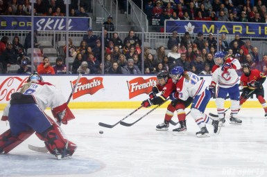 Calgary Inferno forward Rebecca Johnston (6) and Montreal Les Canadiennes defender Melanie Desrochers (17)