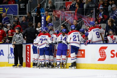 Montreal Les Canadiennes bench huddle