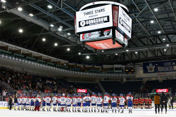 The Montreal Les Canadiennes and Calgary Inferno line up for post-game ceremonies